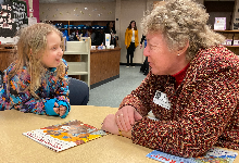 A student and volunteer discussing the book they read together.