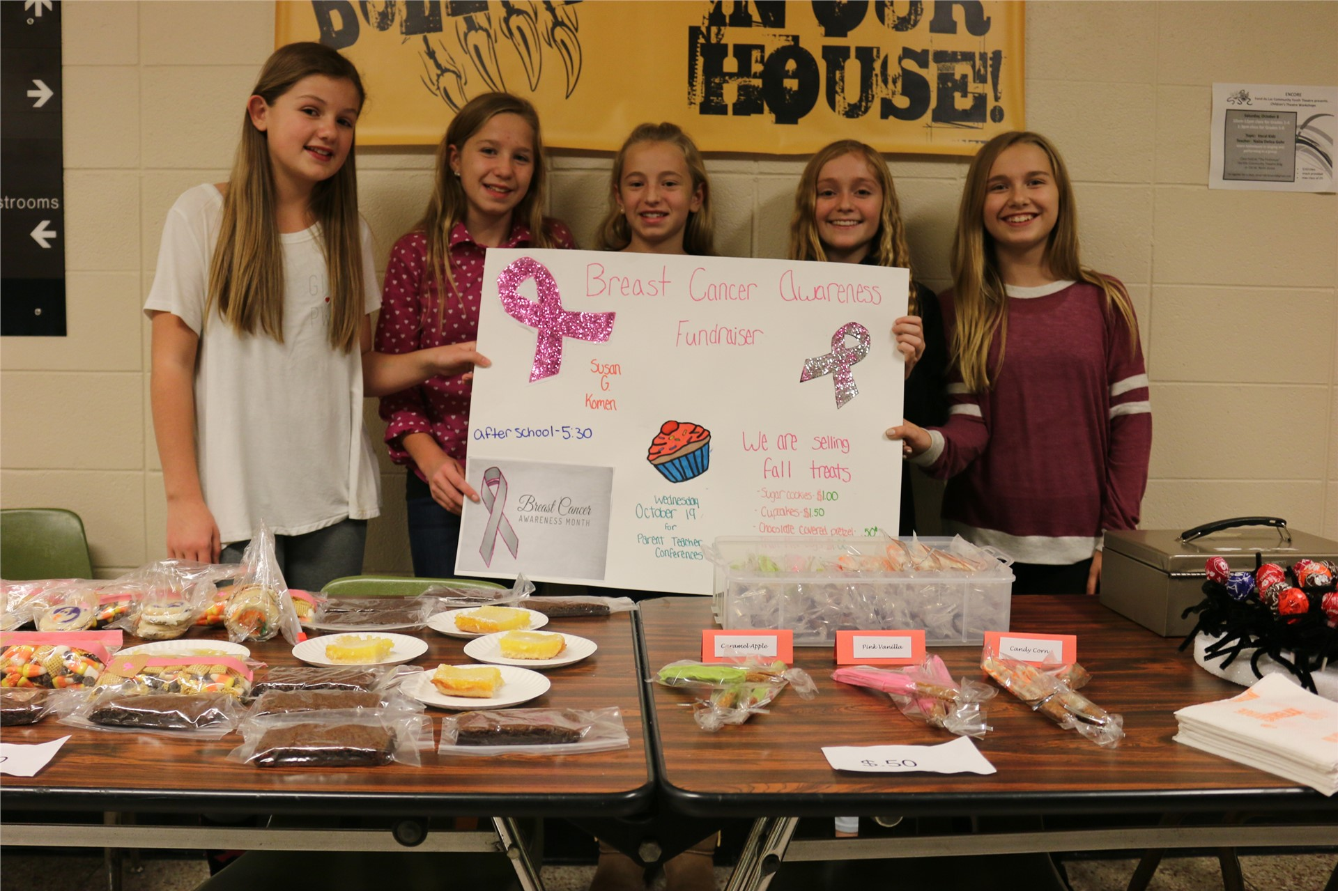 Kaley Sternweis, Mya Van Buren, Grace Guderski, Kendal Maury, and Katey Berger raised 306 dollars for Breast Cancer Research by selling a variety of bake goods. They donated  the money to the Susan G. Komen Foundation.