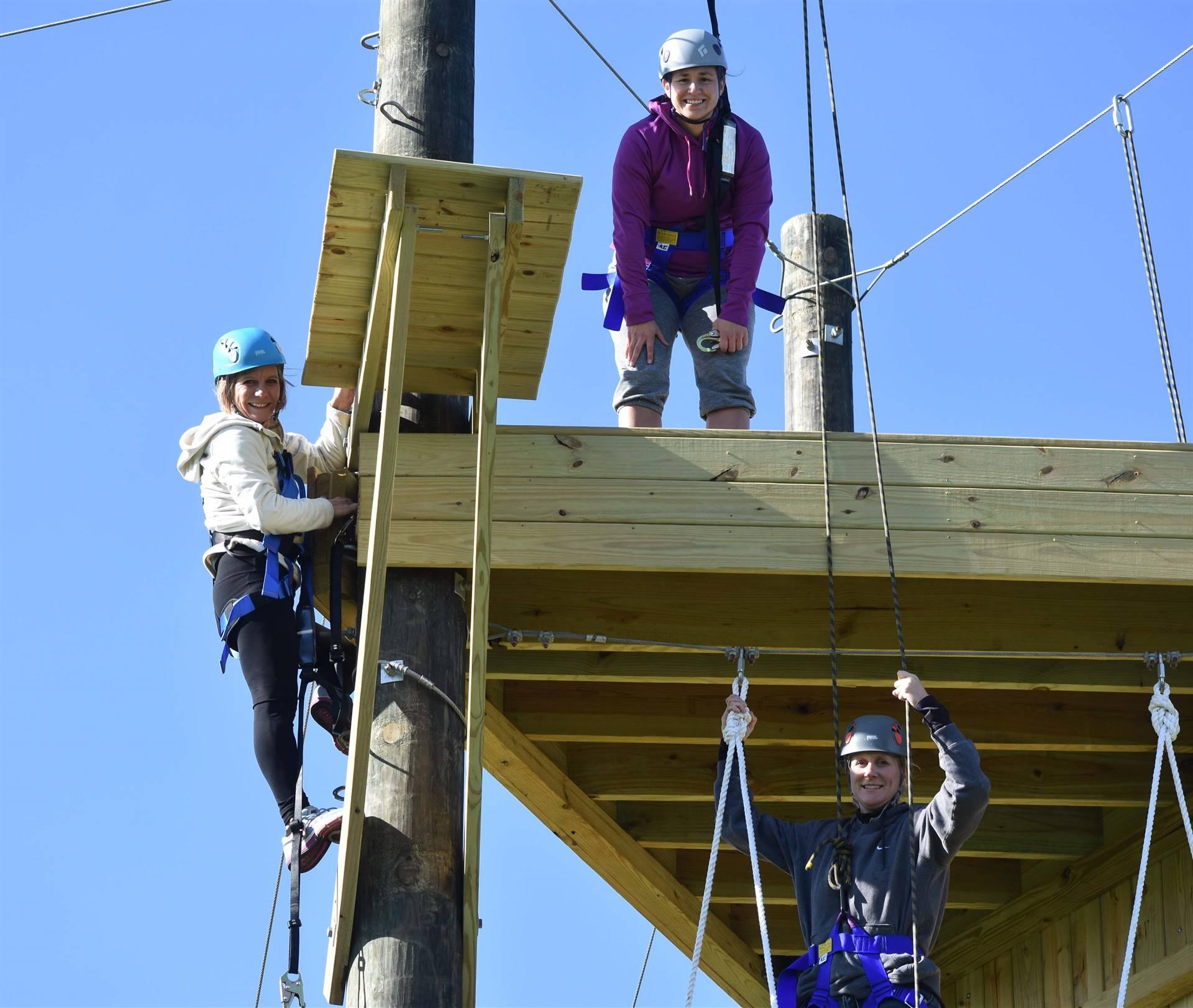 Three teachers on climbing tower