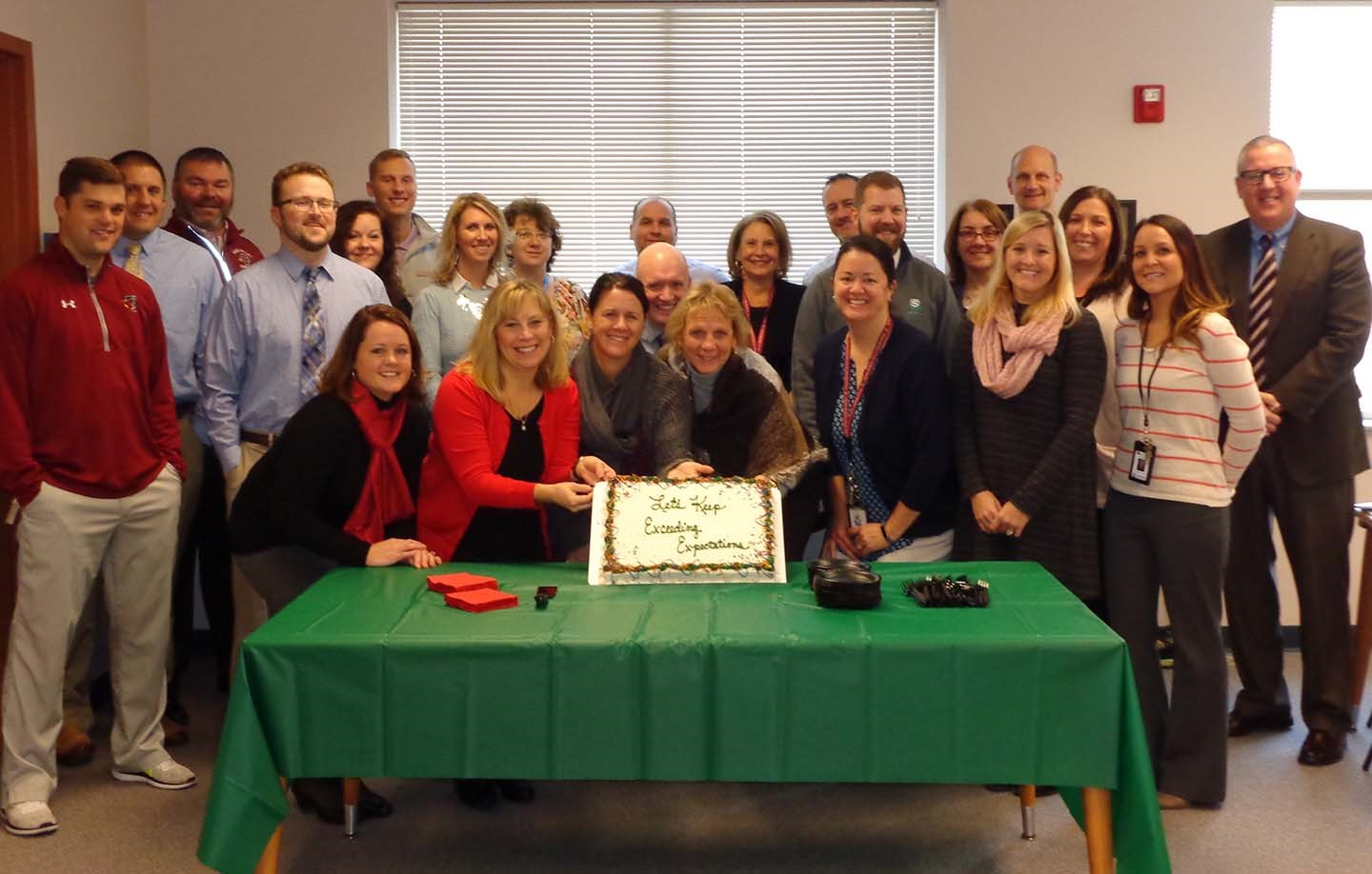 Joint Administrative Team with celebratory cake
