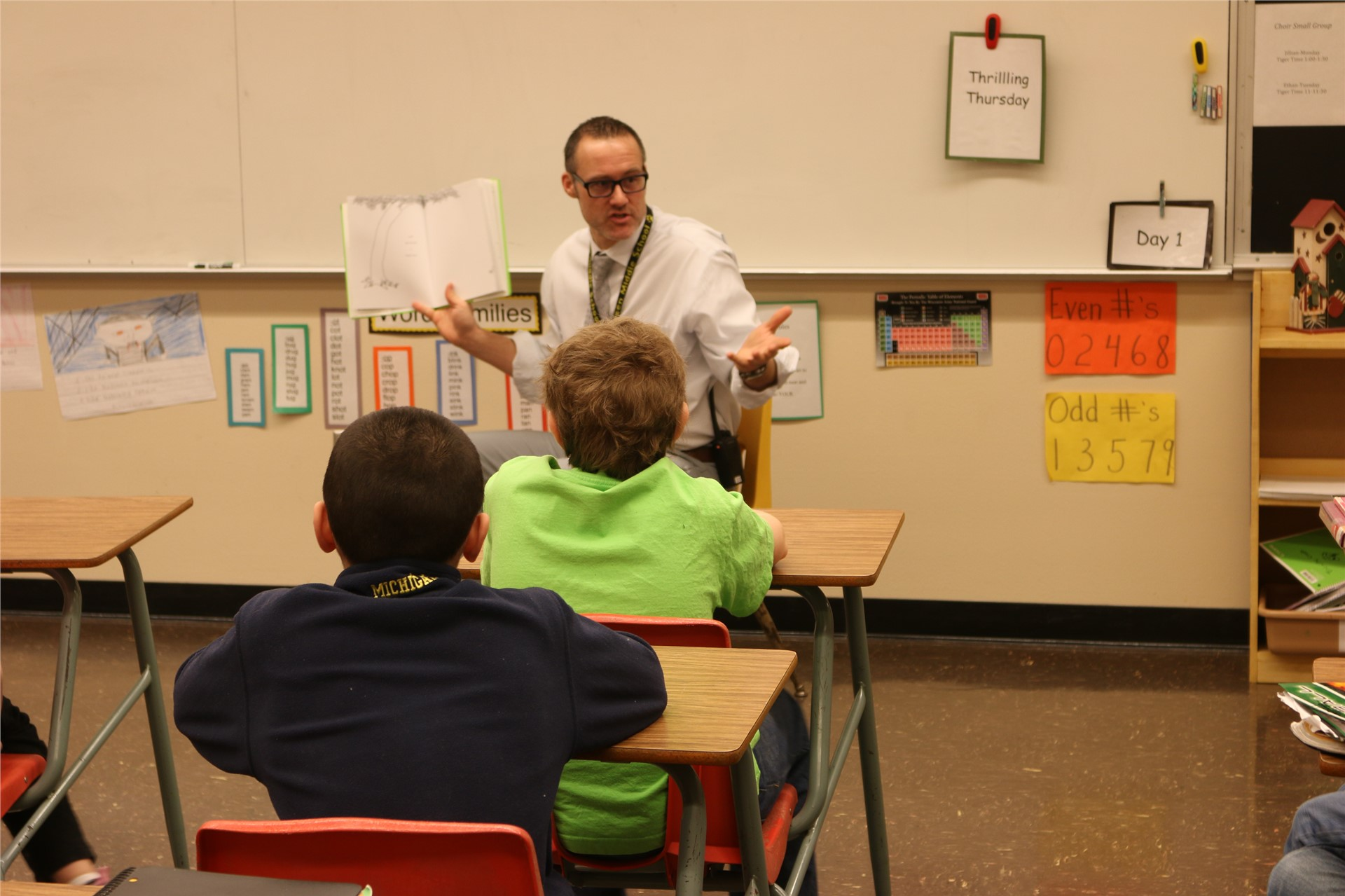 Mr. Nerat reads to a class