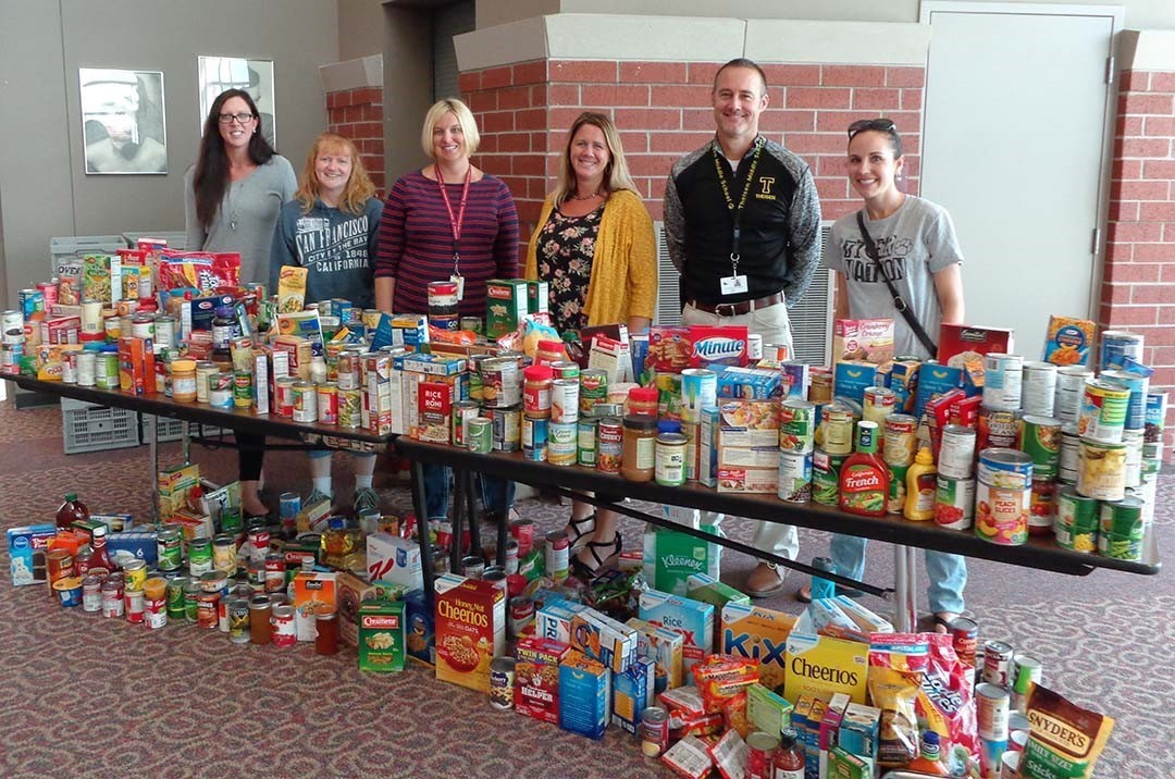 FDLSD staff with canned goods and non-perishables