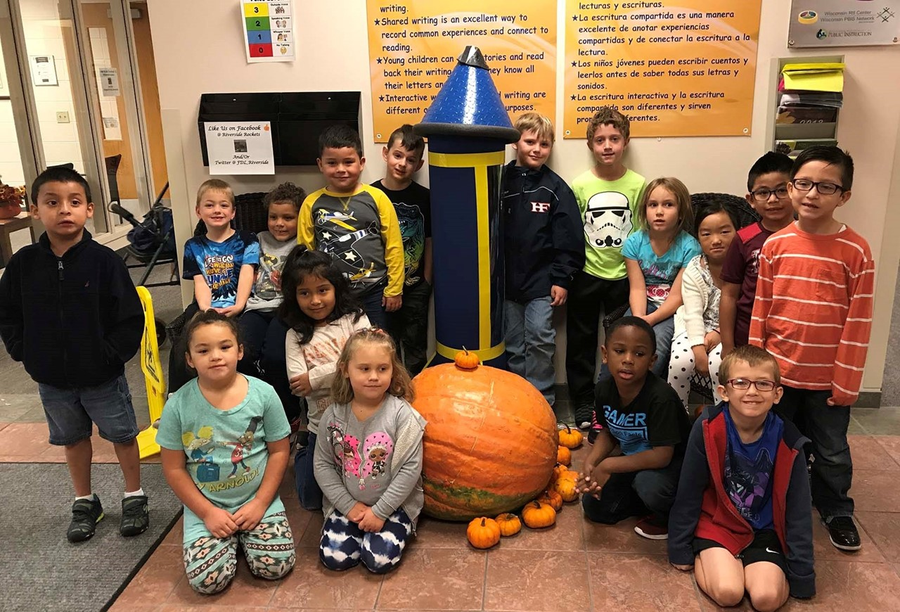 First Graders with a giant pumpkin