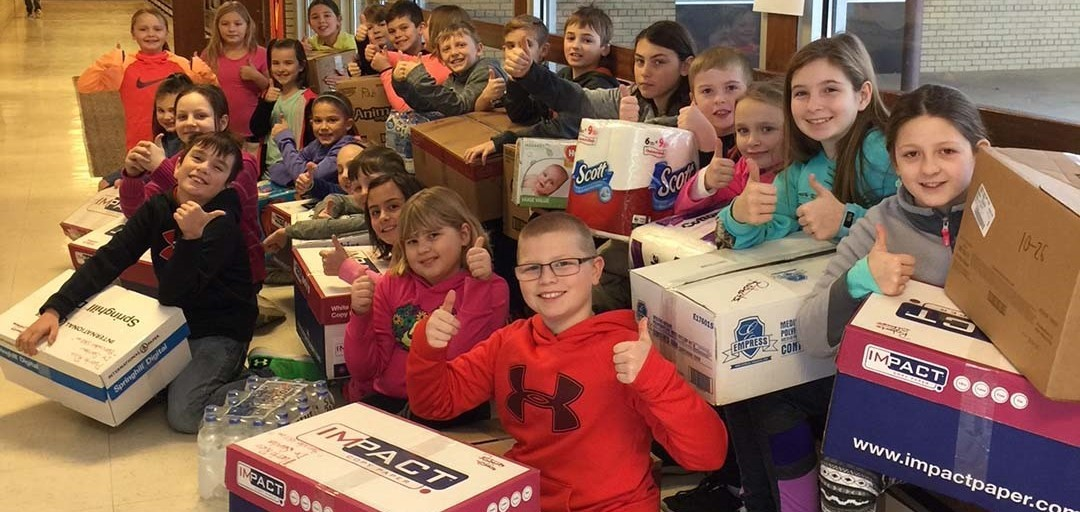 Roberts Students with items for Puerto Rico
