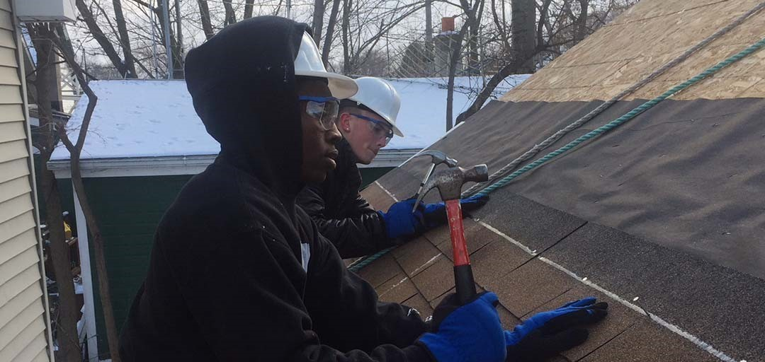 Fondy High Students Shingling Roof