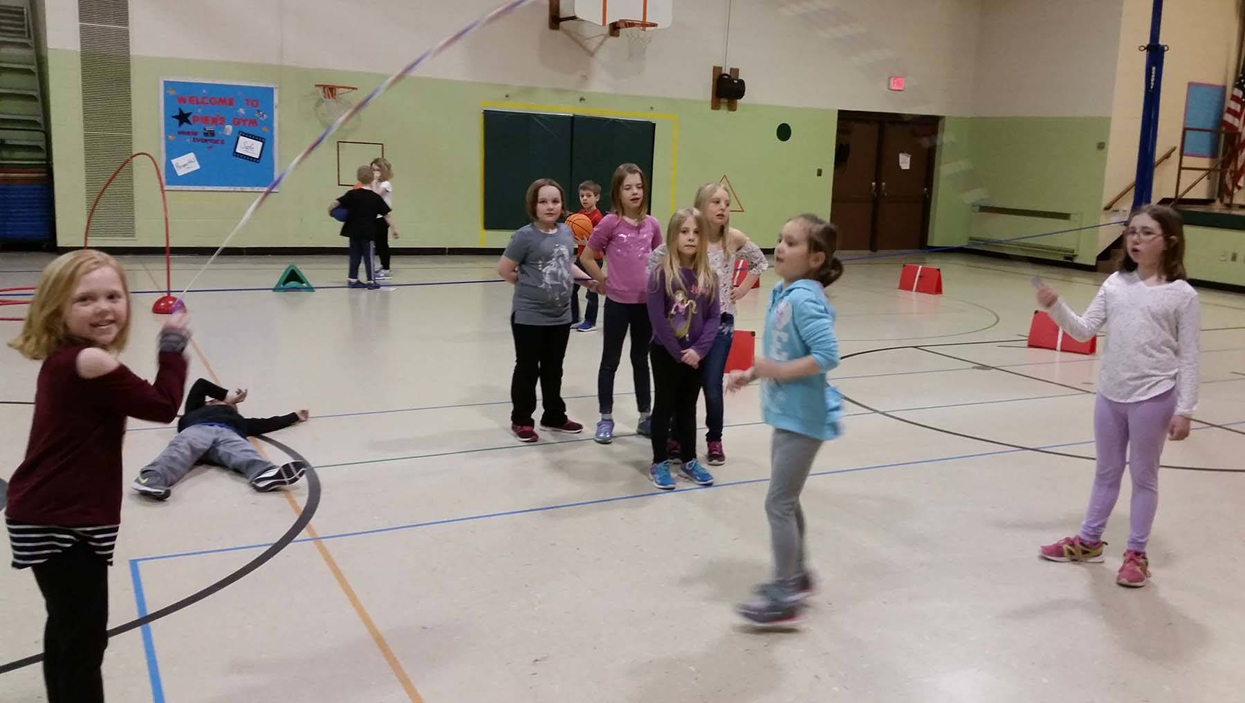 Elementary students jumping rope