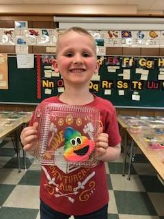 Spring carnival-student holding cookie