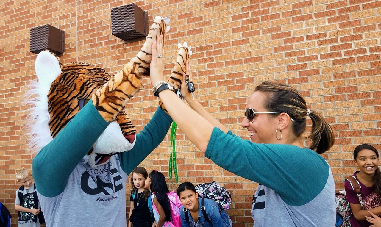 Rosenow Mascot and Teacher Make Arm Bridge