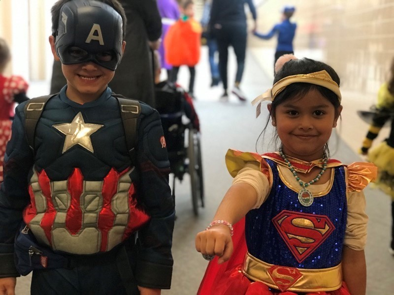 Riverside Students wearing Captain America and Supergirl costumes