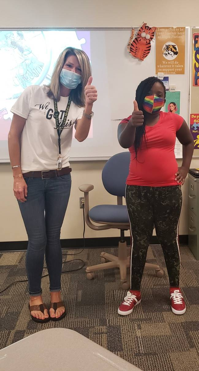 Mrs. Marvin and student