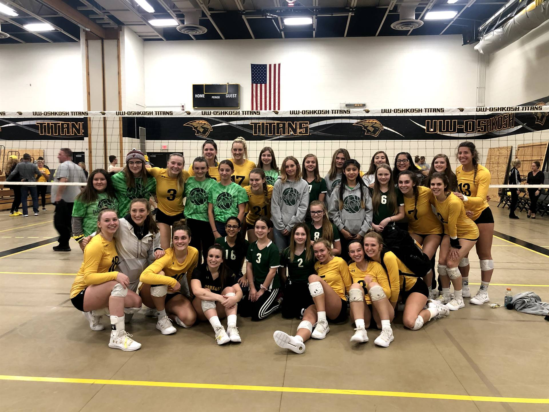 Volleyball team at a an UW-Oshkosh Game