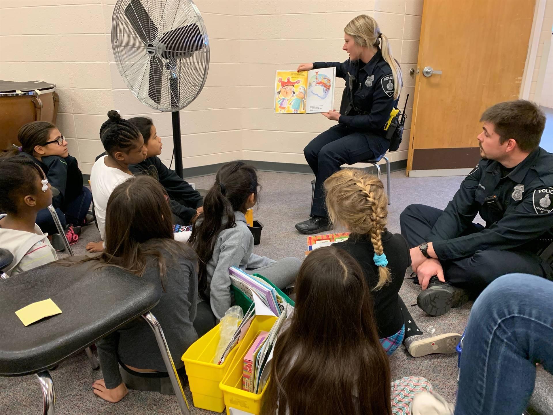 Officer reading to children