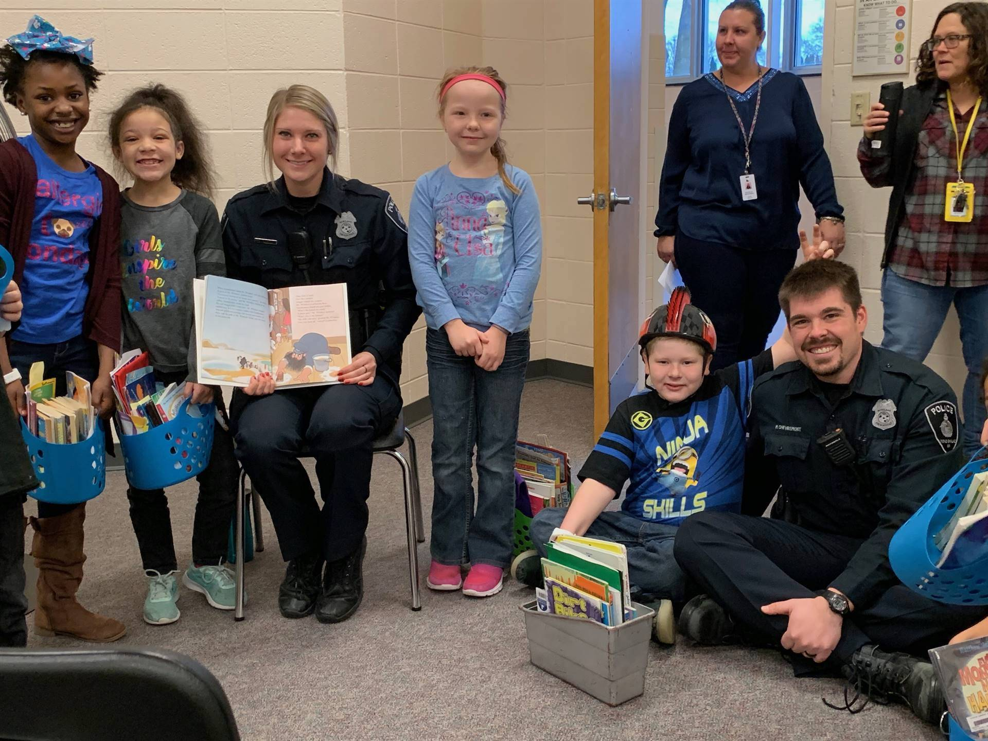 Riverside reading with two police officers
