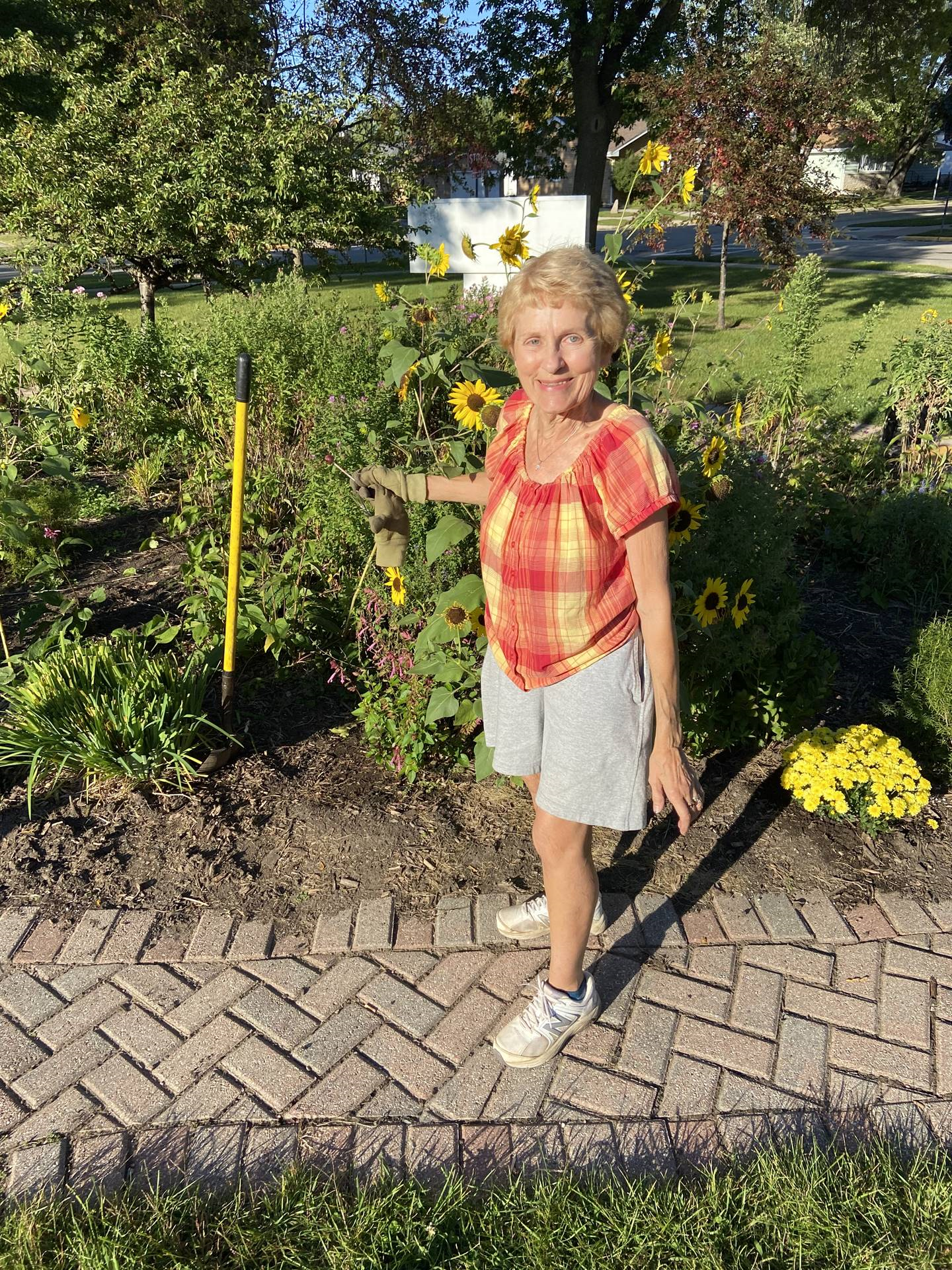 Community member, Anola, tending to our butterfly garden.