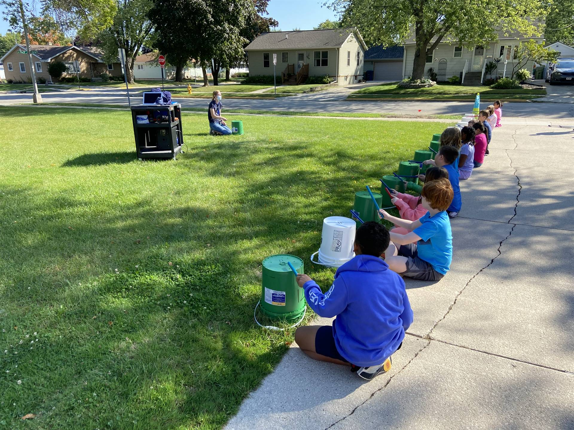 Music class drumming outside.