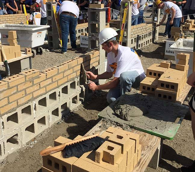 ACE student works on laying bricks