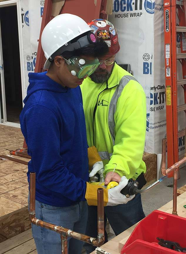 ACE student receives advice from plumbing mentor