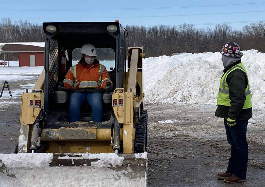 ACE student gets instruction on use of heavy equipment small cat