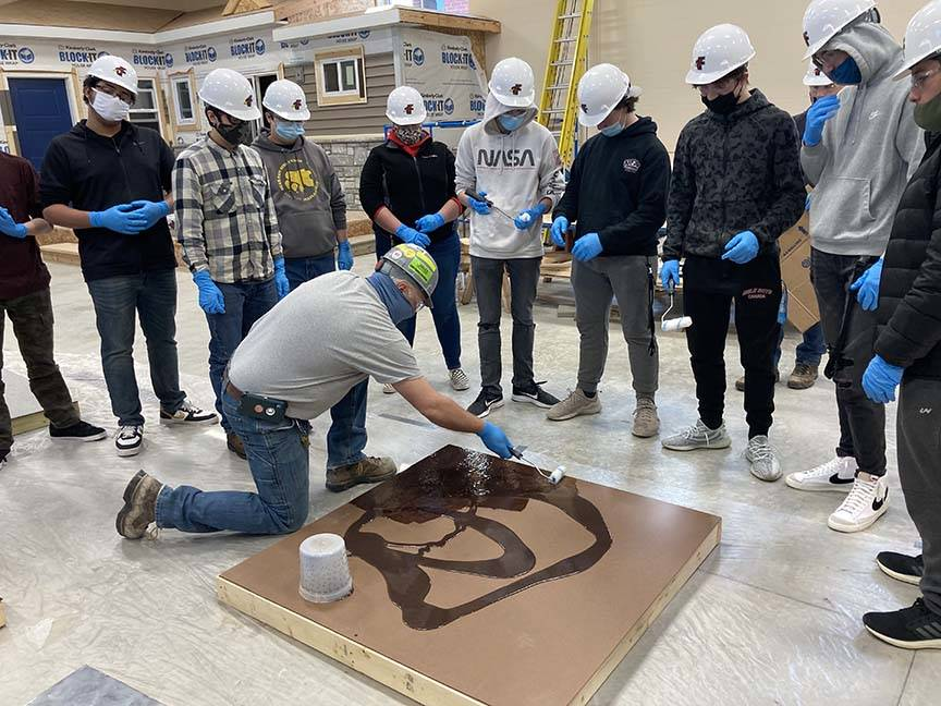 ACE students watch adhesive application demo