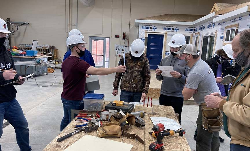 ACE student poses question to carpentry mentor