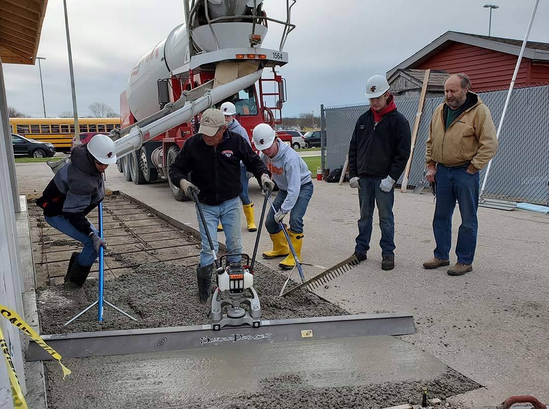 ACE Students participate in concrete pour