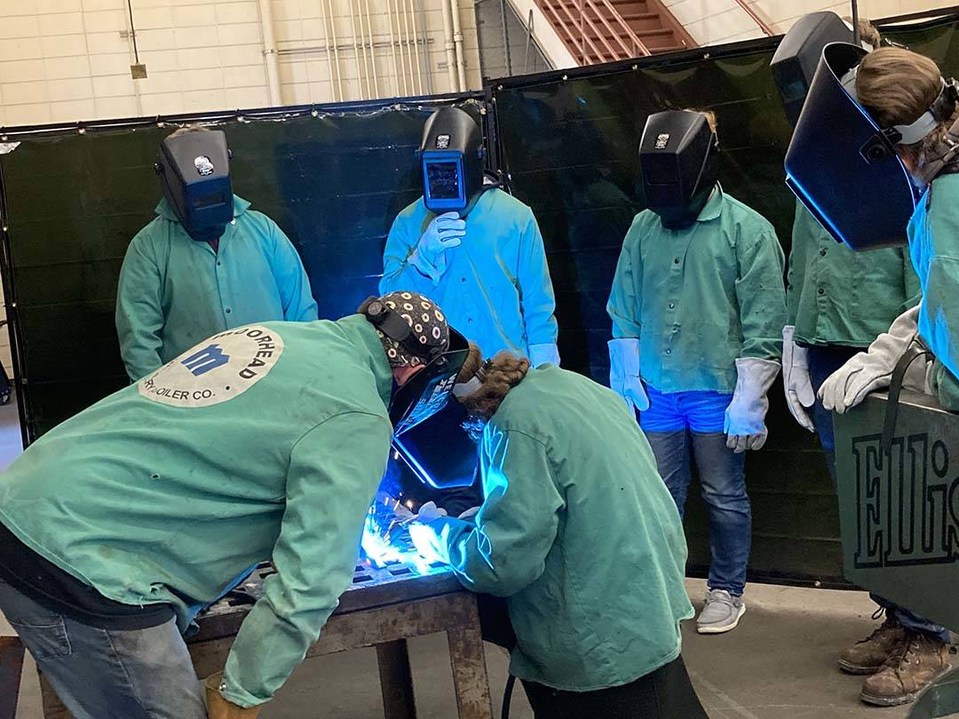 ACE students observe a welding demo