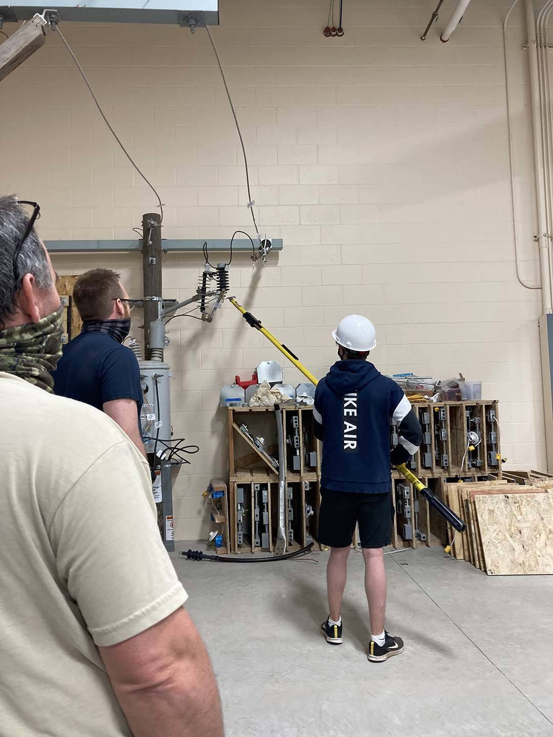 ACE student tries long pole electrical work